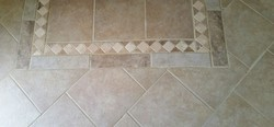Picture of tile and grout after cleaning by Absolutely Kleen in Fairhope, AL
