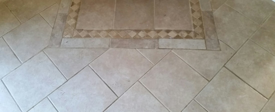 Picture of tile and grout before cleaning