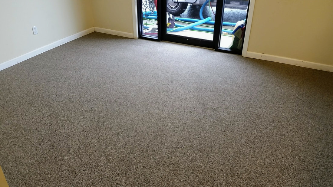Picture after cleaning a commercial carpeting and removing the red clay stains and soiling by Absolutely Kleen of Daphne, Alabama 36526.