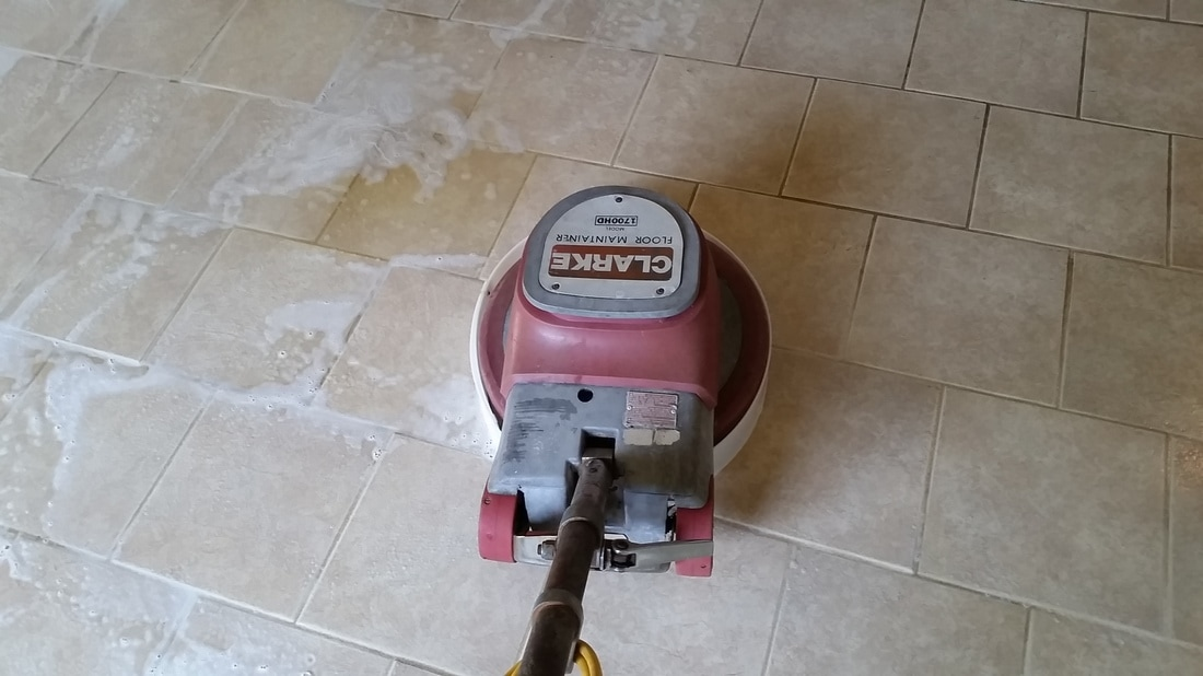 Picture of a mechanical scrubber being used to clean the tile and grout by Absolutely Kleen