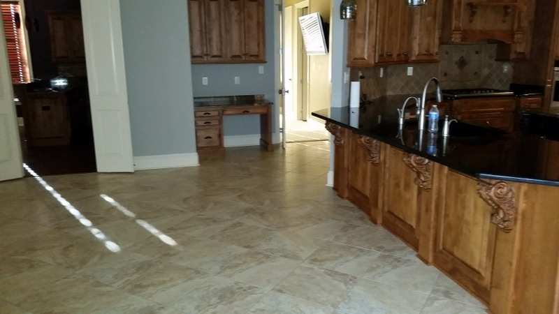 Picture of tile and grout cleaning in the kitchen / living area in Spanish Fort by Absolutely Kleen