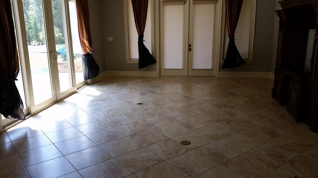 Picture of tile and grout cleaning in Spanish Fort by Absolutely Kleen. It shows the extra steps taken to prevent damage to the Drapes while cleaning the tile.