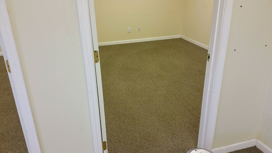This picture shows the carpeting in the office area after being cleaned.