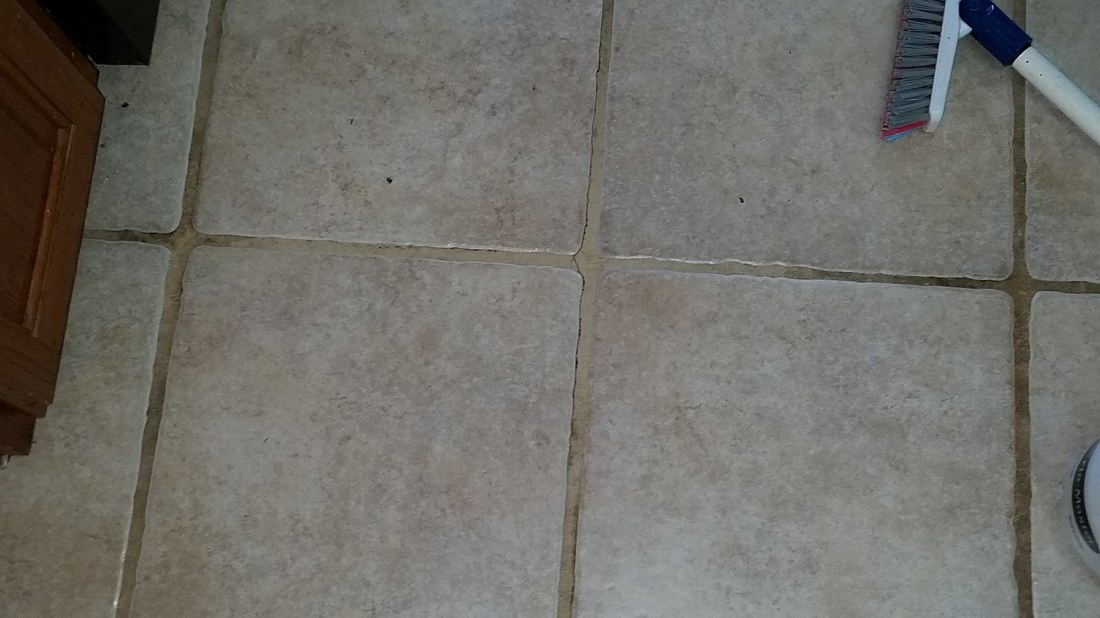 Picture of a test area on tile and grout to determine the cleaning solution needed for the job. By Absolutely Kleen in Daphne, AL.